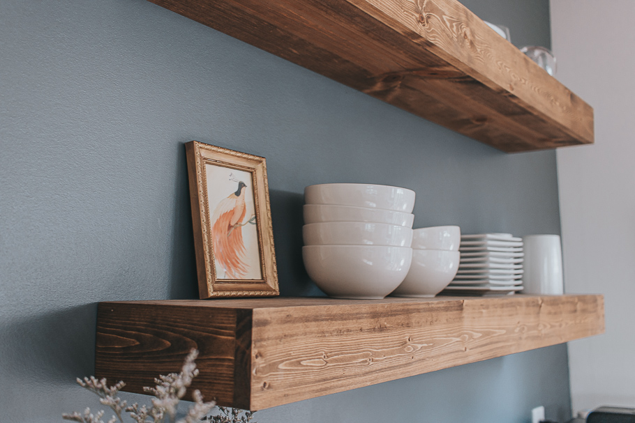gold frame on kitchen wood shelving