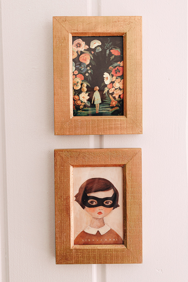 gold antique frames hanging on a wall