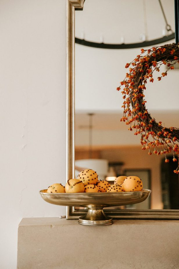 Beautiful Wreath on mirror with clove oranges in a bowl for Fall Decor
