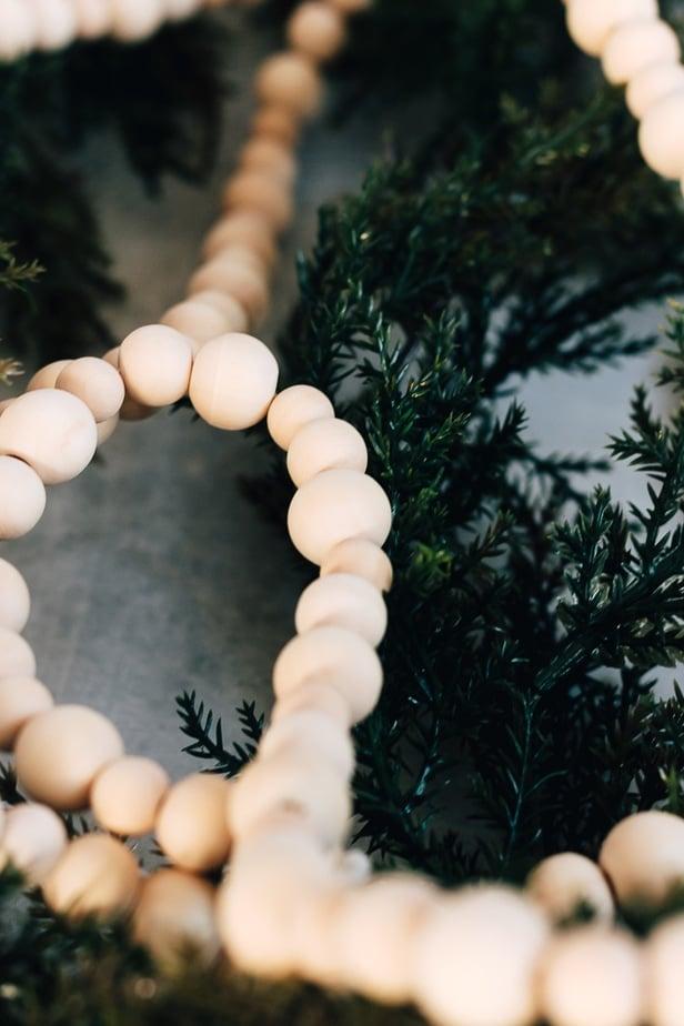 wood bead garland on greenery