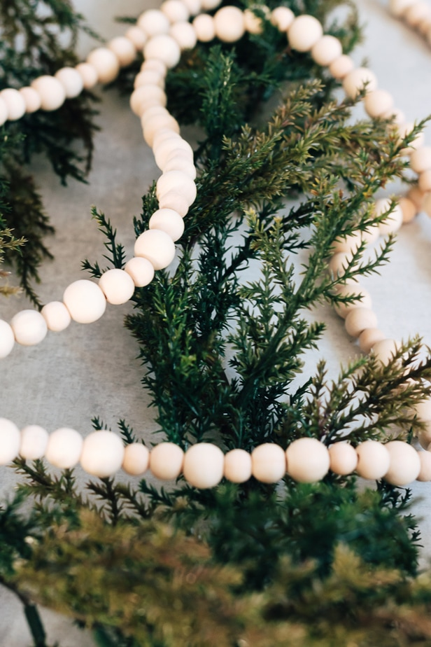 wood bead garland on greenery