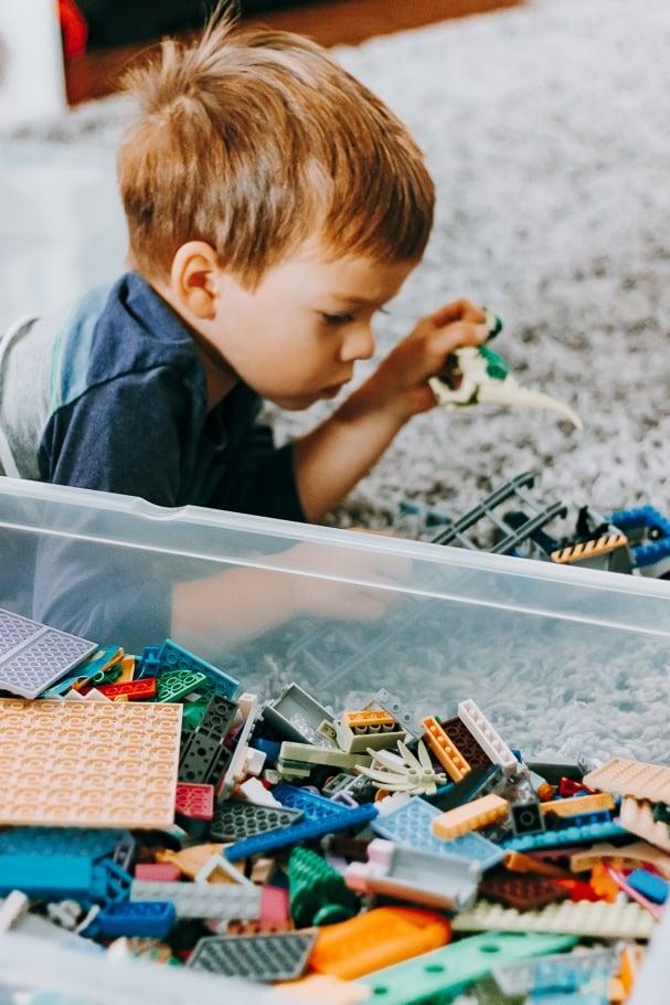 little boy playing legos