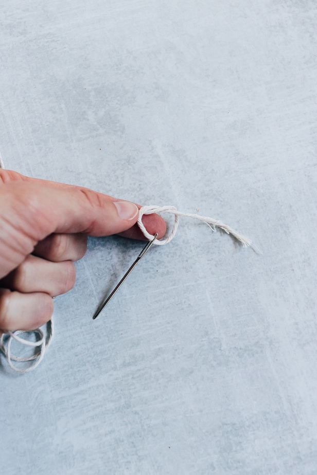 threading a needle and tying a knot