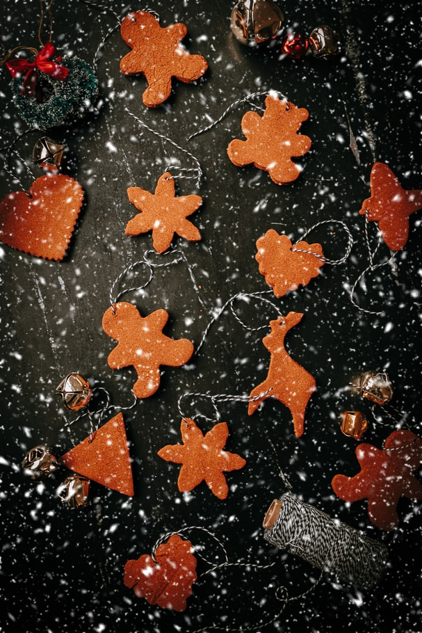 cinnamon ornament cutouts displayed with snow falling
