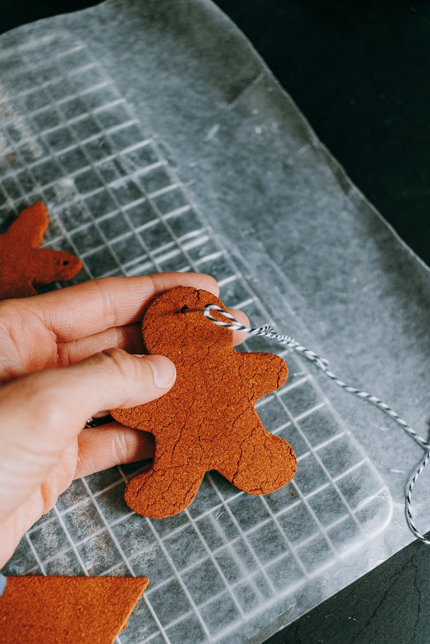 gingerbread man cinnamon ornaments - use needle to thread ornaments