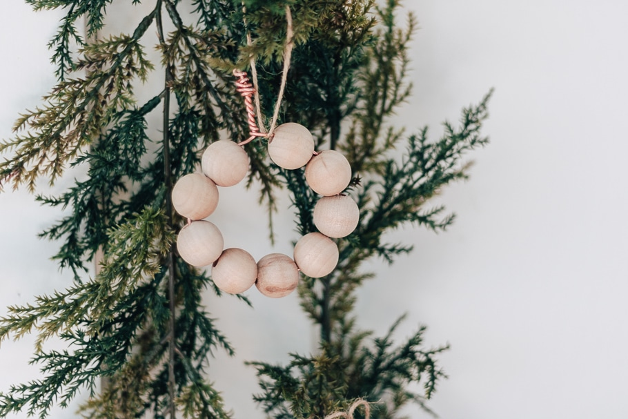 wooden bead ornaments circular hung from greenery