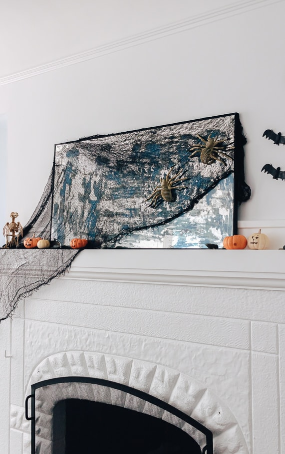 Halloween Mantel Ideas - spooky cloth on mantel mirror