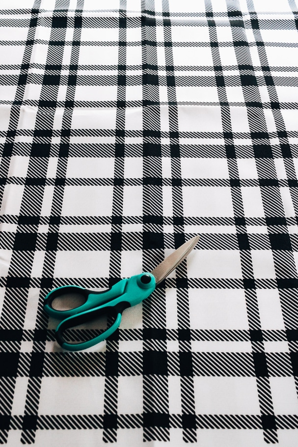 black and white plaid fabric with scissors