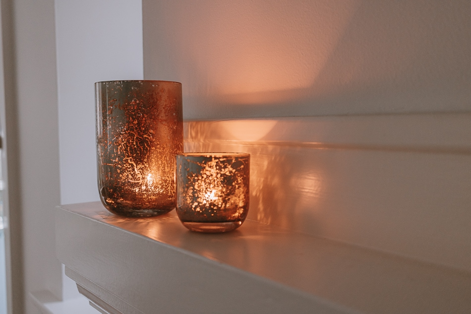 Mercury glass candle holders on a mantel