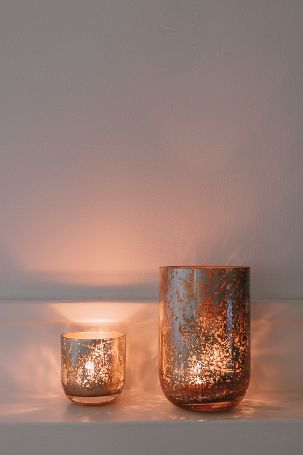 candle holders on a mantel.