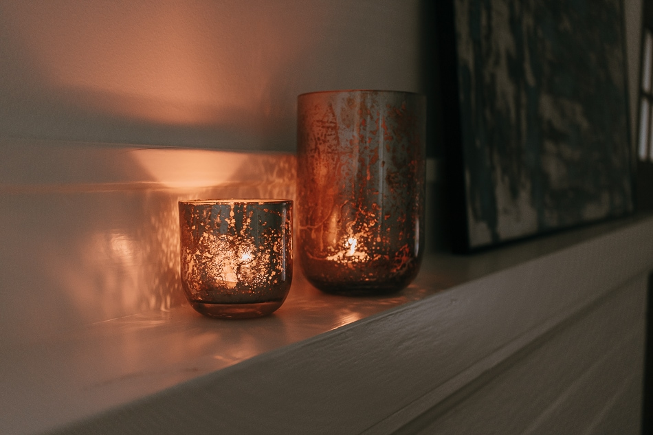 mercury glass candle holders on mantel