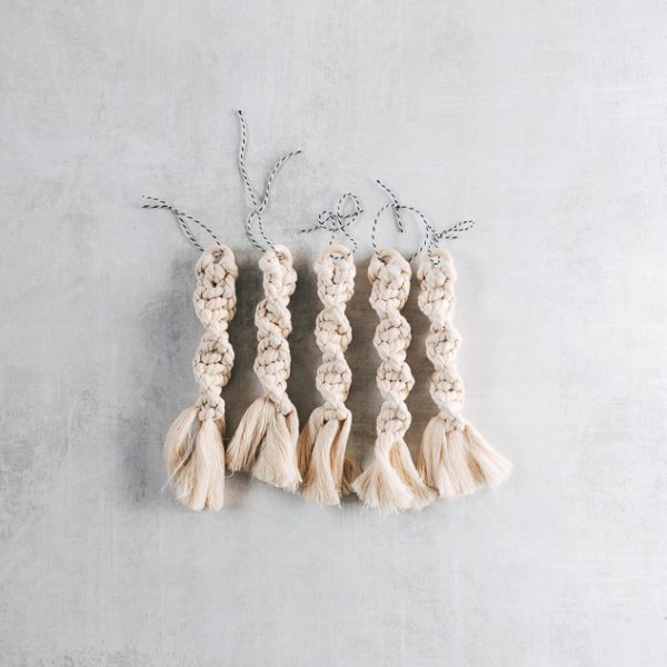showing a row of macrame spiral knots with fringe