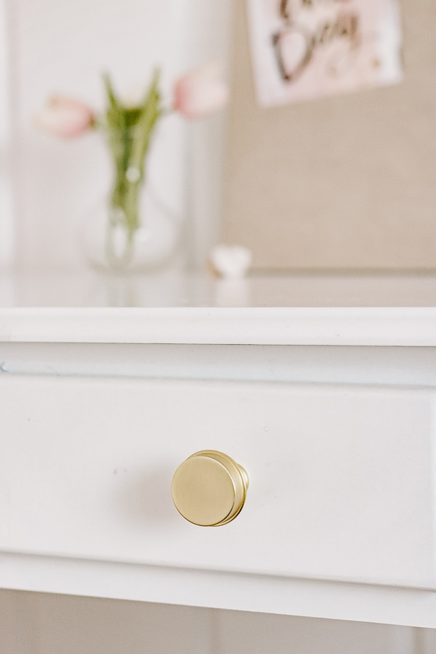 Close up of Gold Desk Knobs on White Desk