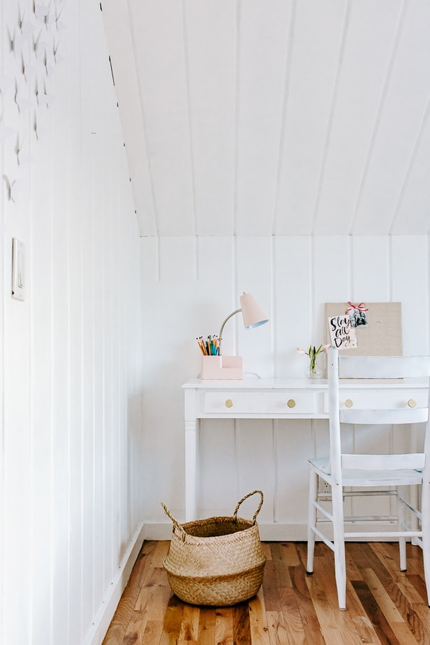 White Desk Area with Basket and Pink Desk Lamp
