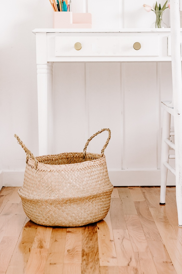 Belly Basket under a White Desk with Gold Knobs