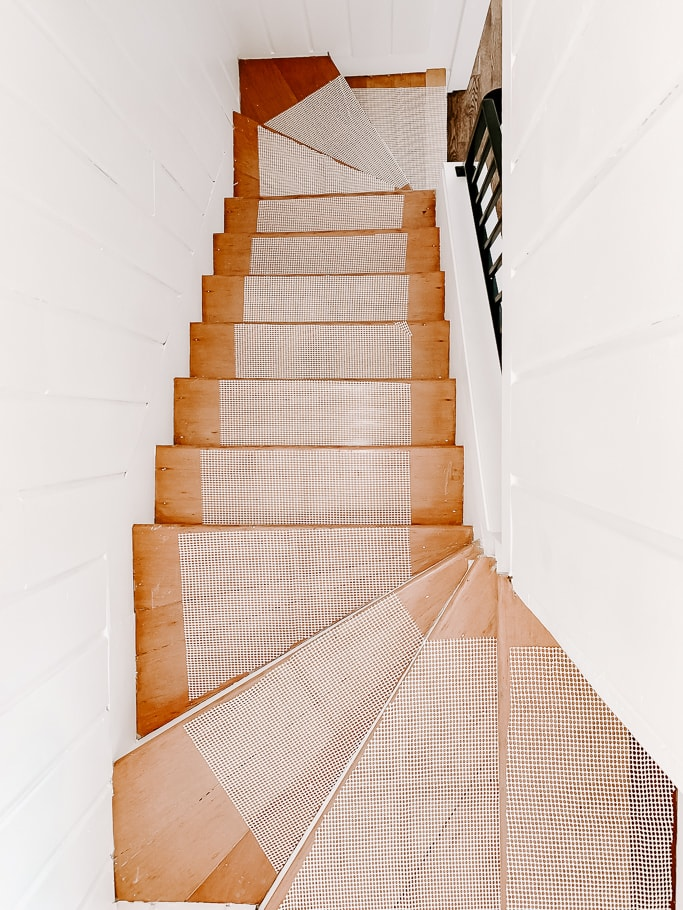 staircase with carpet pad attached