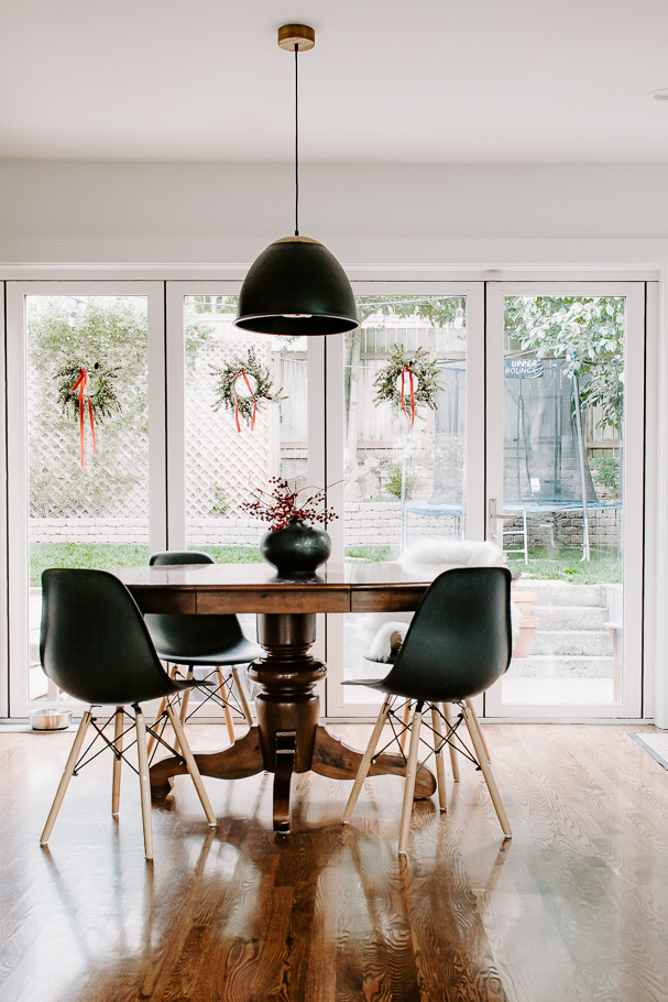 Dining Room with wreaths hanging in the windows