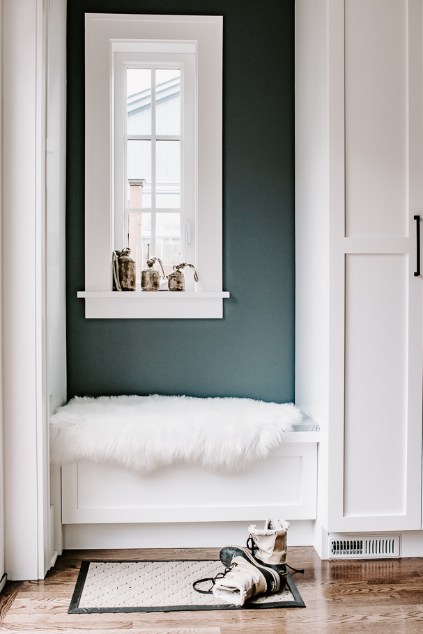 entryway bench with faux fur throw