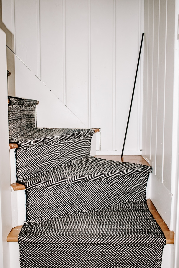 Stair runner with black matte stair rods
