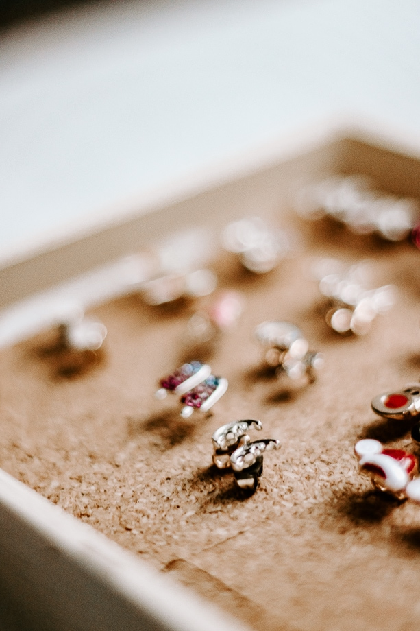 close up of earrings in jewelry holder