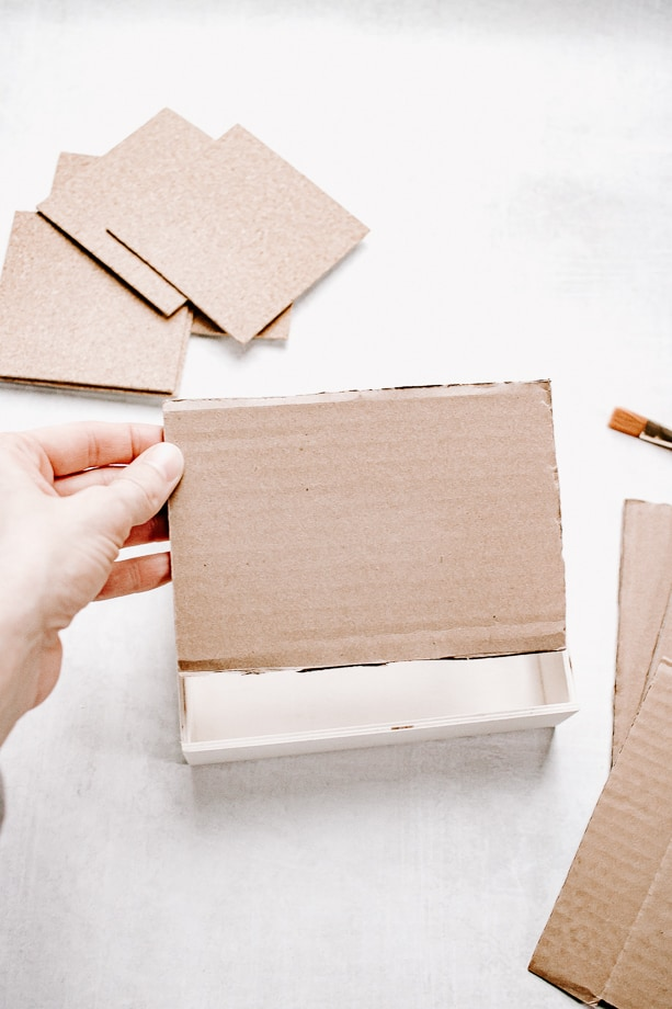 cut cardboard to fit into your jewelry box