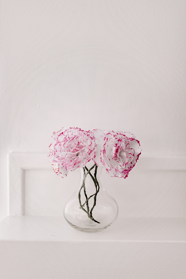 tissue paper carnations in a bud vase