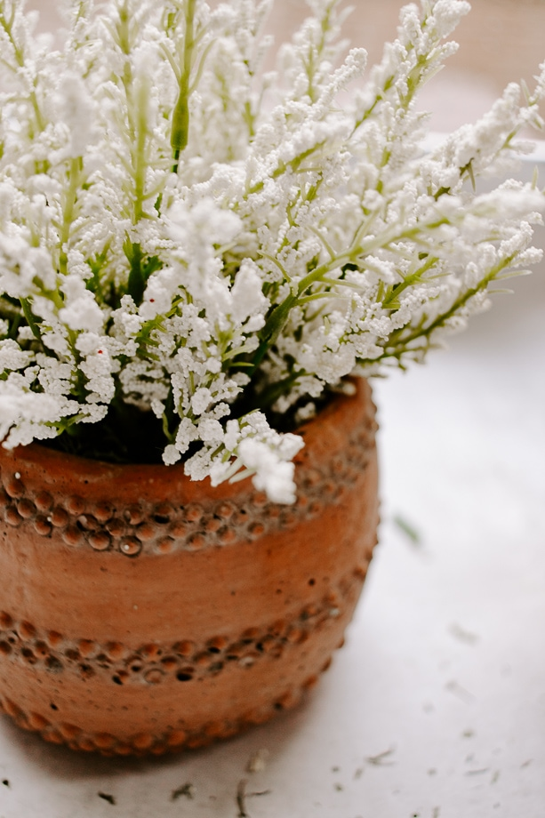 close up of a faux potted flower