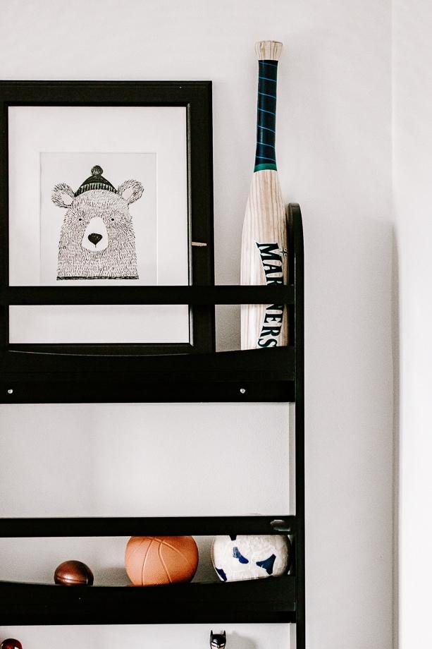 boys room shelving unit with baseball bat and basketballs
