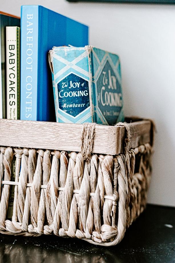 cookbooks organized in basket