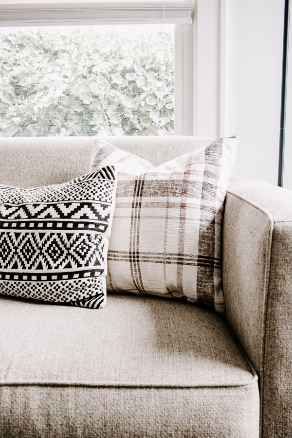 Black and White and Plaid pillow on couch