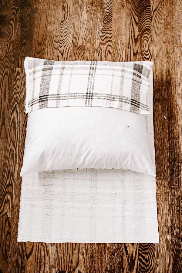 wrap fabric around pillow to measure length