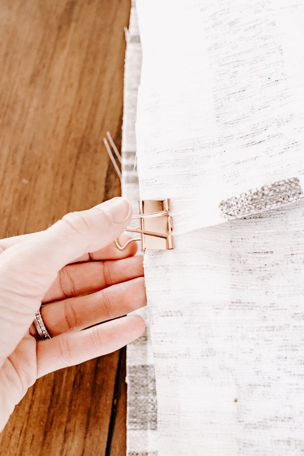 use a binder clip to hold fabric in place