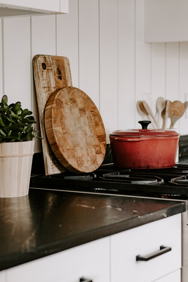 kitchen counter showing cutting boards and red dutch oven