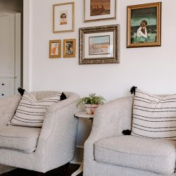 Decorating tips: make a cheap gallery wall on white walls in living room with two chairs