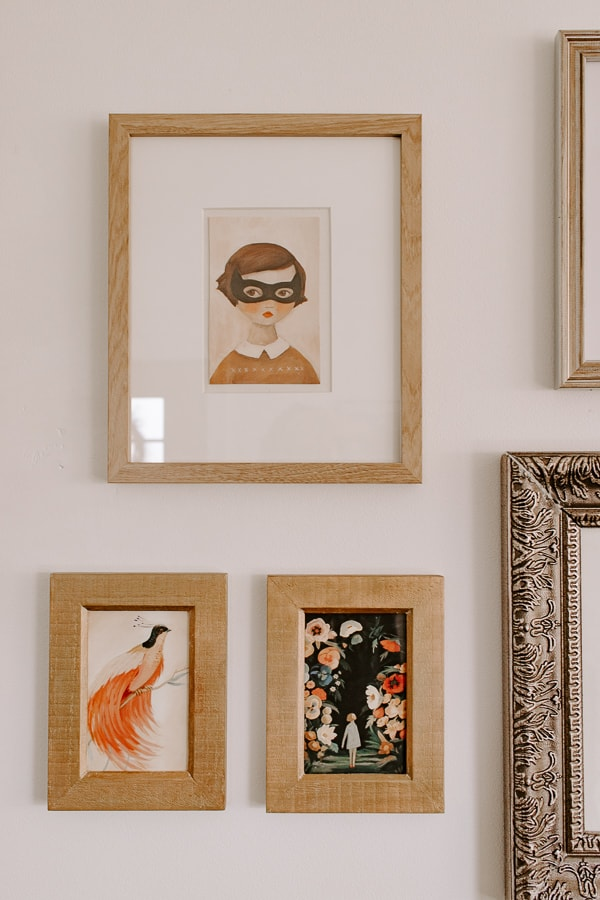 closeup of a gallery wall of prints