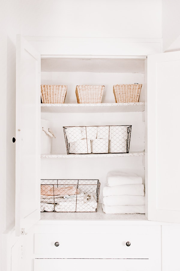 Organize your small linen closet this way!  Tips and ideas in post.