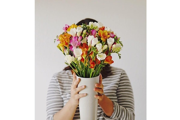 woman holding flowers - Bouqs