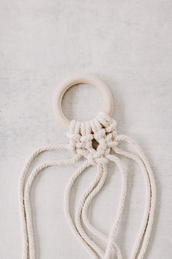Make a series of square knots on your macrame wall hanging
