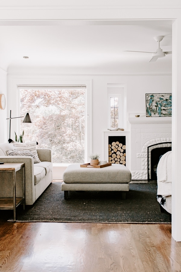 living room showing black natural fiber rug