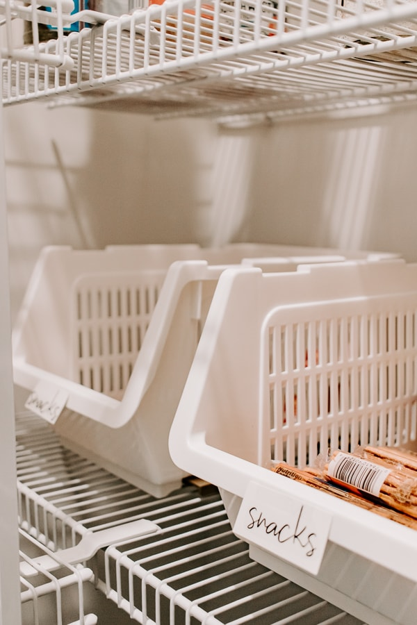 a set of white reach in bins in a pantry - get more ideas for organizing a walk-in pantry