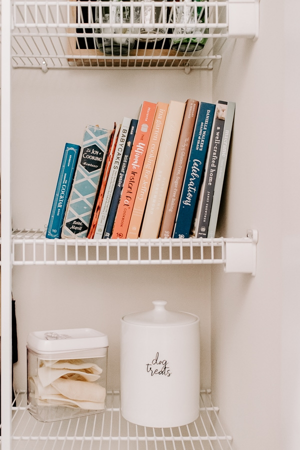 cookbooks arranged on a shelf in a pantry