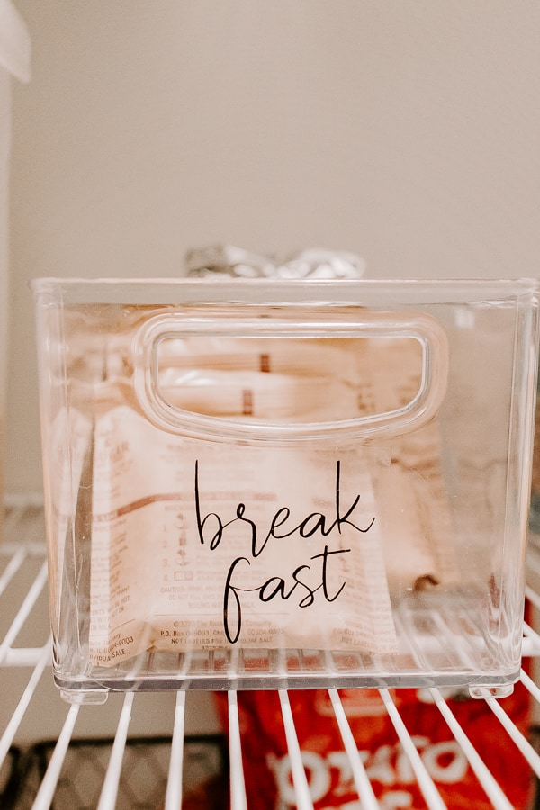 close up of a clear bin for organizing with a breakfast label
