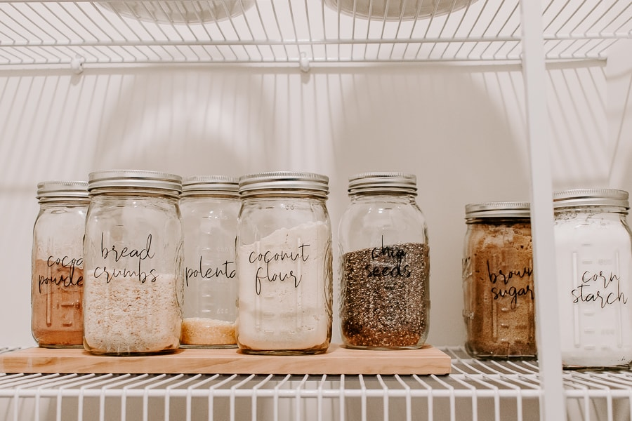 mason jars labeled with dry goods in them