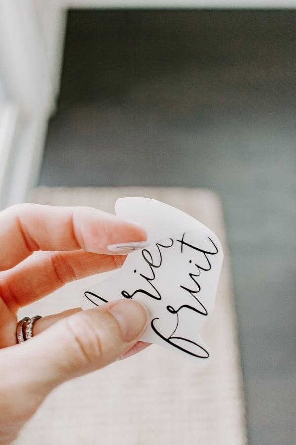 peeling a clear label sticker off a sheet