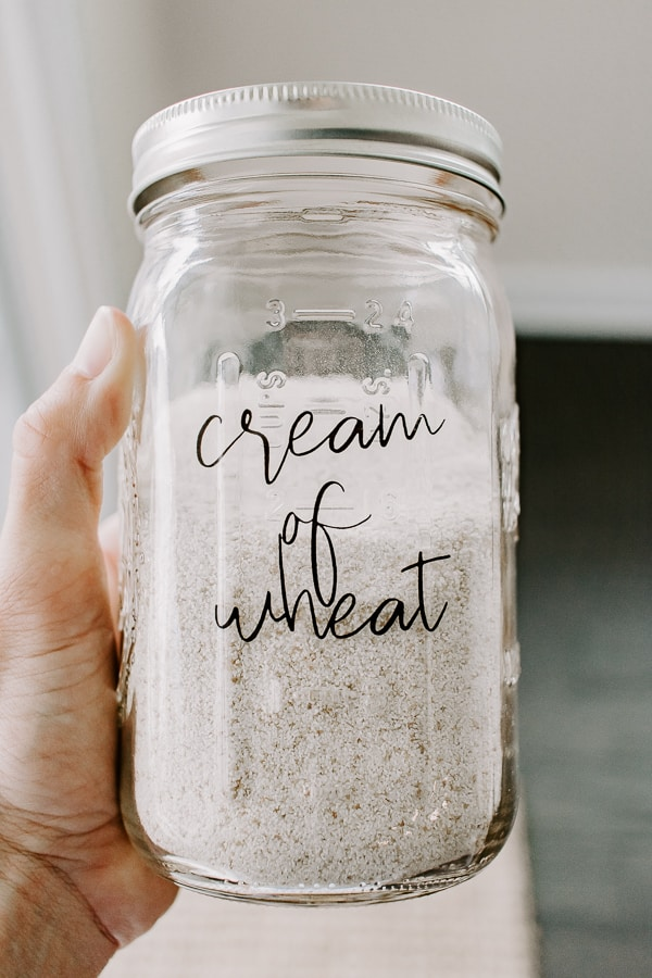 holding a mason jar labeled cream of wheat