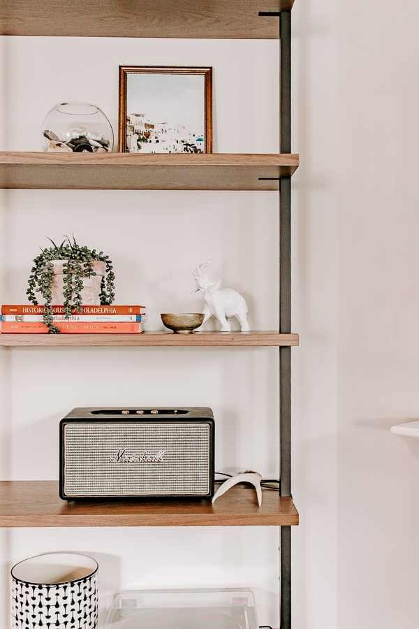 a marshall speaker on an etagere bookcase