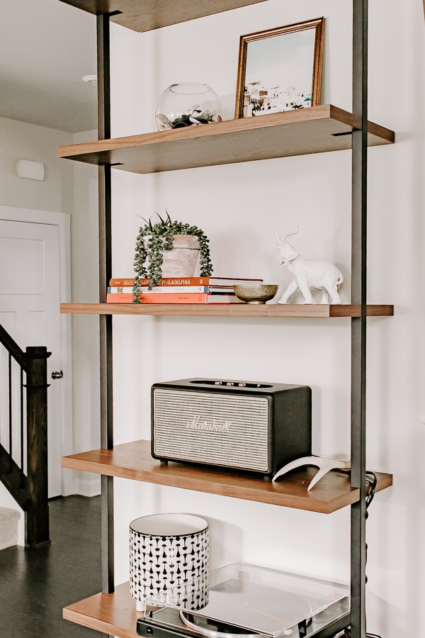 a close up side view of an etagere bookshelf