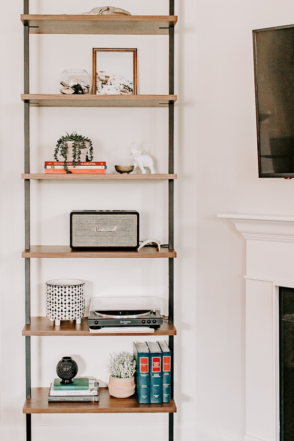 view of an etagere bookcase decorated