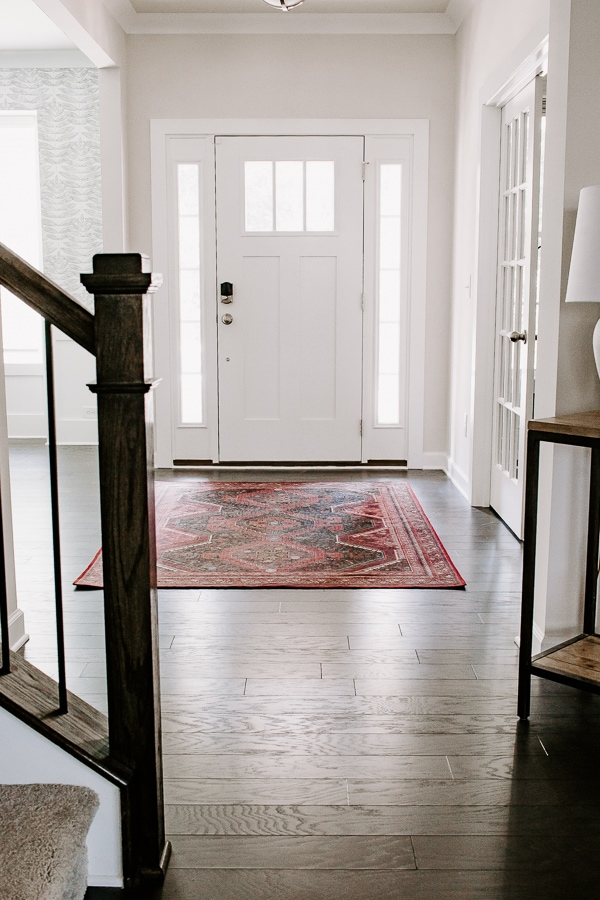 foyer room with a red rug