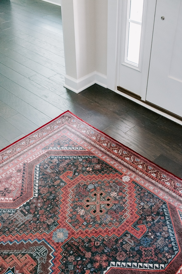foyer rug on dark hardwood floors